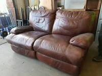 Brown leather electric reclining two seater sofa