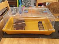 Hamster gerbil mouse cage. Plastic so sawdust doesn't get out everywhere hardly used