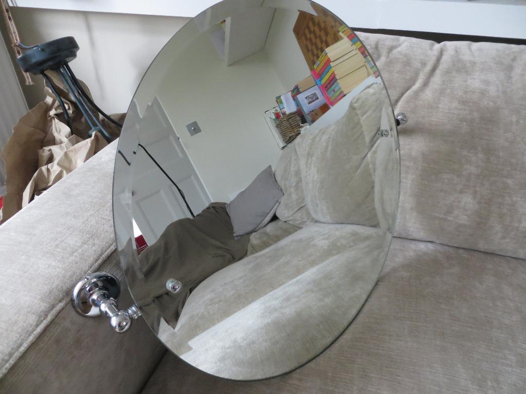 Samuel Heath round tilting bathroom mirror in Wimbledon London