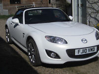 Mazda MX5. Great driving all year round but summer is on it's way!
