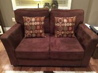 Two Matching Love Seat Sofas