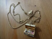 Disney Couture Necklace and Pendant, jeweled enamelTreasure Chest with gold chain. Must go!