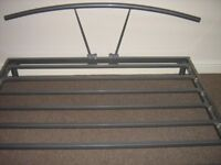 Silver coloured modern metal king sized bedframe.