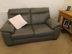 Two 2 seater Grey leather sofas