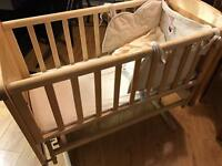 Mothercare swinging crib with Winnie the Pooh bale and 5 spare fitted sheets (2 still unopened)