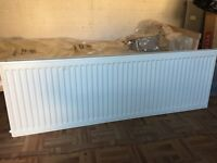 Single Radiator 1400cm long x 450cm high with brackets, Stelrad Compact, side panels,