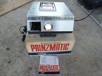 Pre – owned 35mm Slide projectors, storage magazines, mounts and Da Lite Tripod projection screen
