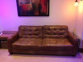 Three seater brown leather sofa DFS