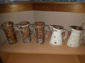5 white and brown rustic jugs