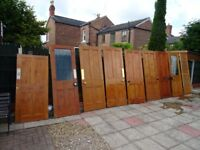 9 vintage pine panel doors for sale with handles, varying sizes inc. 2 x half-glazed & 1 x louvre