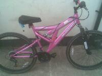 Girls Muddyfox Aphrodite 26 Inch Full Suspension Mountain Bike in Pink.