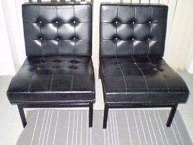 2 BLACK VINYL COVERED CHAIRS