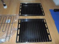 HOTPOINT OVEN PARTS, ELEMENT, 2 TRAYS WITH GRILLS AND 2 KNOBS.