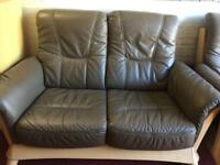Brown two seater sofa and armchair