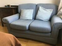 Blue M&S two seater sofa