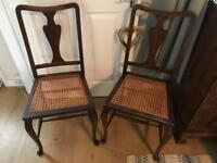 Two french style wooden carved rattan cane dining chairs