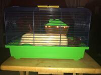 Brand new in box, small hamster cage and start up set
