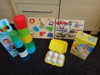 ELC stacking cups, hide 'n' squeak eggs and wooden jigsaws