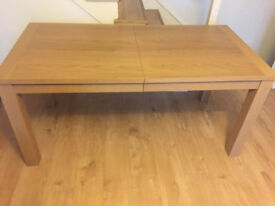 Large extendable Real Oak Veneer Dining Table. Only couple of months old. King's Cross collection