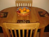 Dining Table (Extendable) and 4 Chairs - as new.