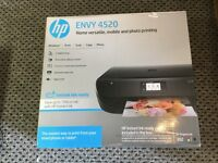 HP Envy 4520 all in one wireless printer/copier/scanner, used once, still boxed.
