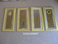 4 matching , artistic flower images in gold coloured frames