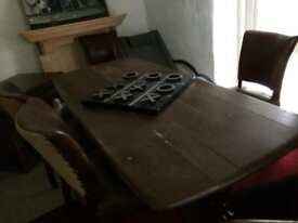 Table and six leather chairs