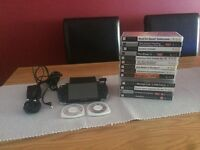 Sony PSP with charger and 16 games and 8GB SD card