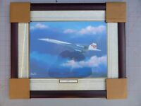 A WOODEN FRAMED GLAZED PRINT OF CONCORDE