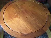 Rosewood round Dining Table s in the Long Life design
