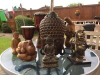 Assortment of Buddha and African masks ornaments