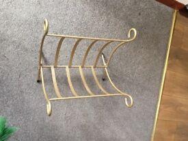 Gold coloured metal paper rack