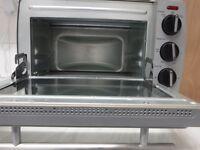 mini oven, mixer pot and baking stuff