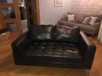 Two seater black sofa
