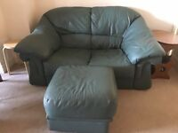 Comfortable green leather two seater sofa and large foot stool-free