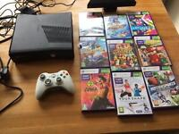 Xbox 360 s console and Kinect with games