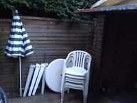 Set of six plastic garden / patio chairs & table & umbrella