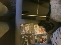 PS3 console with four games and one controller