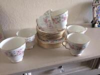 Tea cups, saucers and side plates