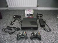 3.2 GB Xbox 360 Slim, 2 Controllers, 8 Games, Headset & Rechargeable Kit