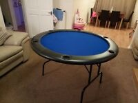 Electric blue Poker table with padded arm rest and drinks holders.