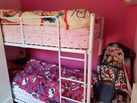 White metal frame bunk bed