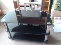 Good condition dark glass &chrome TV/ MUSIC SYSTEM shelf unit