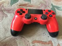 PS4 CONTROLLER RED IN FULL WORKING ORDER
