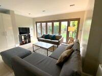 Corner Sofa bed and footstool - Dark grey