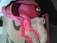 ice skating boots and pink skate bag
