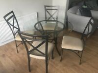 Dining Set - glass topped table and 4 metal chairs