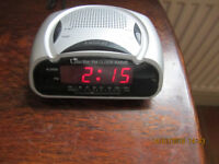 FM CLOCK RADIO it works and is cheap and you could always make an offer