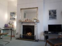 Charming light and airy 1 bedroom holiday apartment with garden close to the sea front and town