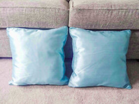 2 turquoise satin effect cushions. As new.